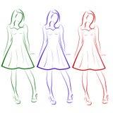Insieme di vettore di un disegno di profilo colorato di tre ragazze in vestiti Fotografia Stock