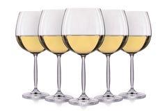 Insieme di vino bianco in un vetro su fondo bianco Immagini Stock Libere da Diritti