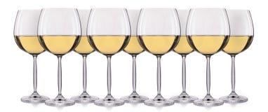 Insieme di vino bianco in un vetro su fondo bianco Fotografia Stock