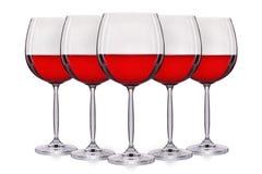 Insieme di vino rosso in un vetro su fondo bianco Immagine Stock Libera da Diritti