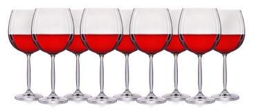Insieme di vino rosso in un vetro su fondo bianco Immagini Stock