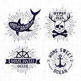 Insieme disegnato a mano dell'annata dei distintivi con il cranio del pirata, squalo, ancho Fotografie Stock Libere da Diritti