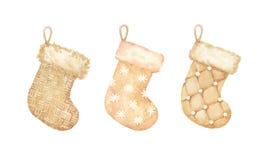 Insieme dorato d'annata di spirito tricottato e di lana delle calze di natale illustrazione di stock