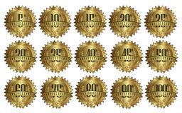 Insieme dorato del distintivo dell'etichetta di marchio di anniversario Fotografia Stock Libera da Diritti