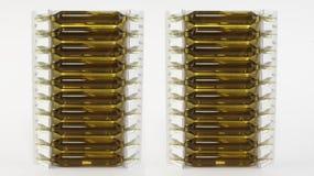 Insieme isolato delle ampolle nel fondo bianco Fotografie Stock