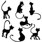 Insieme nero della siluetta del gatto illustrazione di stock