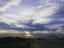 Insieme nuvoloso del sole fotografia stock