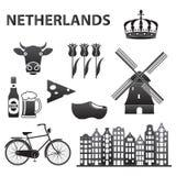 Insieme olandese dell'icona isolato su fondo bianco Simboli di Amsterdam e dell'Olanda: mulino di vento, tulipani, bicicletta, bi illustrazione di stock