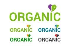 Insieme organico variopinto piano dell'emblema di logo, cuore con permesso organico verde illustrazione di stock