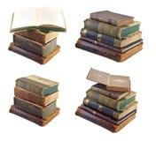 Mucchi dei vecchi libri messi Immagini Stock