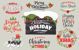 Insieme progettazioni di iscrizione del buon anno e di Natale nei colori tradizionali Immagini Stock