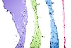 Insieme variopinto della spruzzata dell'acqua isolato su fondo bianco Immagini Stock