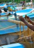 Insiemi del pescatore dell'attrezzatura di pesca Fotografia Stock