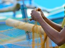 Insiemi del pescatore dell'attrezzatura di pesca Immagine Stock
