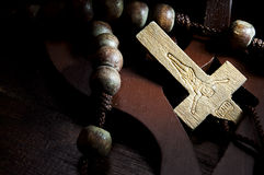 Insight revelation on the cross. Insight light on the cross wood with prayer beads Stock Photos