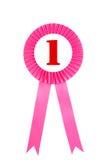 Insigne rose de rubans de récompense avec le fond blanc Photo libre de droits