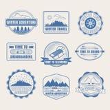 Insignes d'aventure d'hiver réglés illustration libre de droits