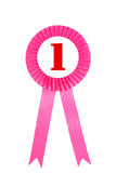 Insignia rosada de las cintas del premio con el fondo blanco Foto de archivo libre de regalías