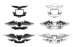 Insignias coas alas blancos y negros Imágenes de archivo libres de regalías