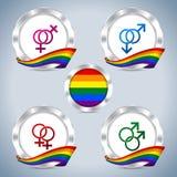 Insignias metálicas con la cinta y símbolos del orgullo gay Foto de archivo