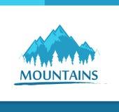 Insignien mit Bergen und Wald Stockfotografie