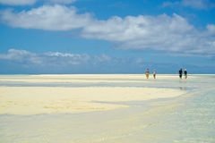 Insignificant people on coral island. Stock Photography