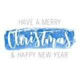 Inskrift för hand för glad jul skriftlig Arkivfoton