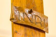 Inskrift på korset av Jesus Christ Arkivbilder