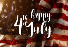 Inskrift som är lycklig 4th Juli med USA flaggan Royaltyfria Foton