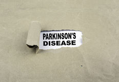 Inskrift som avslöjs på gammalt papper - Parkinson& x27; s-sjukdom royaltyfri fotografi