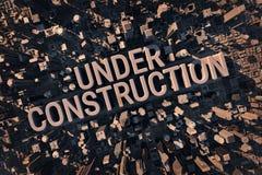 Inskrift under konstruktion som lokaliseras inom en stor stad royaltyfri illustrationer