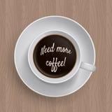 Inskriftbehov mer coffe i en kopp kaffe Royaltyfria Foton