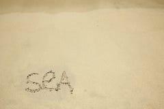 Inskriften på sanden vid havet Royaltyfri Bild