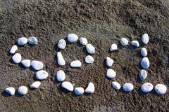 Inskriften på sandhavet royaltyfri bild