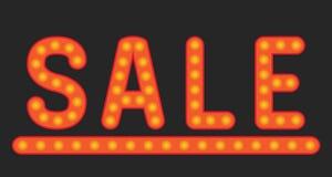 Inskriftförsäljning av lampor Arkivbild