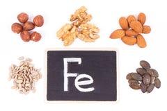 Inskrypci Fe, zdrowy karmowy zawiera żelazo, witaminy, kopaliny i żywienioniowy włókno, obraz stock
