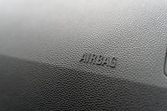 Inskrypcja na panelu pojazdu airbag tło popielaty textured klingeryt obrazy stock