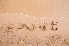 Inskrypcje na piasku: ucieczka Zdjęcia Stock