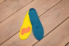 Orthopedic insoles on wooden boards. Insoles for flatfoot. insoles close up. medical insoles. orthopedic purpose insoles. insoles for problem feet royalty free stock image