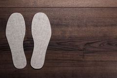 Insoles for shoes on wooden background Stock Photography