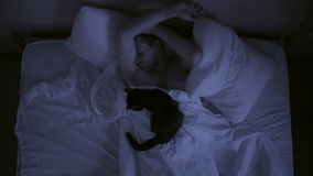 Insomnia concept. man in bed at night can not sleep, Time lapse stock footage