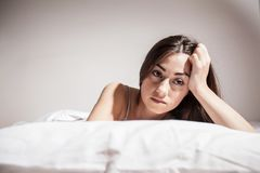Insomnia depressed woman. Depressed Young woman with insomnia in bed cant sleep Royalty Free Stock Image