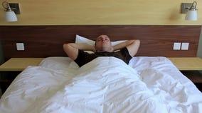 Insomnia. Restless sleeping man timelapse stock video footage