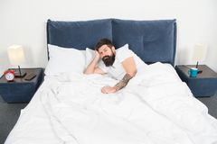 Insomnia. Sleep disorders concept. Man bearded hipster having problems with sleep. Guy lying in bed try to relax and. Fall asleep. Relaxation techniques stock images