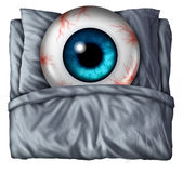 Insomnia. And sleeping problems concept as a human eye ball with red veins in a bed with a pillow as a symbol of the health risks of nighttime sleeplessness Royalty Free Stock Photography