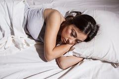 Insomnia sleepless depressed woman. Sleepless woman lying in bed Royalty Free Stock Photo