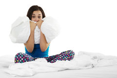 Insomnia. Stock image of insomniac woman on bed over white background Stock Images