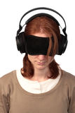 Insomnia - Unable to Sleep. A young woman with a blinder and large headphones trying to fight insomnia (being unable to sleep Royalty Free Stock Photography