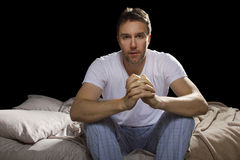 Insomnia. Young man unable sleep because of stress of problems stock photography
