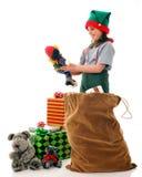 Inspecionando os brinquedos Fotografia de Stock Royalty Free